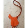 Saddle Charm in Orange in Swift Palladium Hard Ware in New Condition