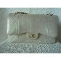 Chanel Jumbo size in Champagne color in phyton leather (snake skin) with gold chain in brand new condition