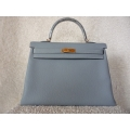 Kelly in Bleu Lin size 35 in Togo Leather with Gold hard ware in Second Condition
