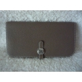 Wallet Dogon Long in Etoupe color in Togo leather with palladium hard ware in brand new condition
