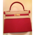 Kelly size 32 in Vermillon (Red) Color in Togo Leather with Gold Hardware in New Condition, Stamp #Q