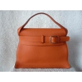 Kelly Etribelt in Orange in Togo leather with Palladium hardware in new condition