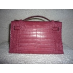 Kelly Pochette in Bois the Rose (dark pink) in Niloticus crocodile matte finished with Palladium hardware in second condition