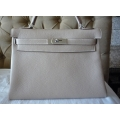 Kelly size 32 in Argile Color in Clemence Leather in Palladium Hard ware in Second Condition