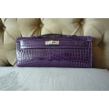 Kelly Cut in Amethyste Color in Nilo Shiny Leather with Palladium Hardware in New Condition