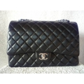 Chanel Maxi in Black Lamb Skin leather with Palladium hardware in new condition